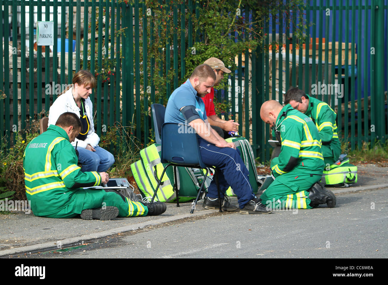 Paramedics from the East Anglian Ambulance Service tend to casualties following a chemical incident in Somersham, - Stock Image