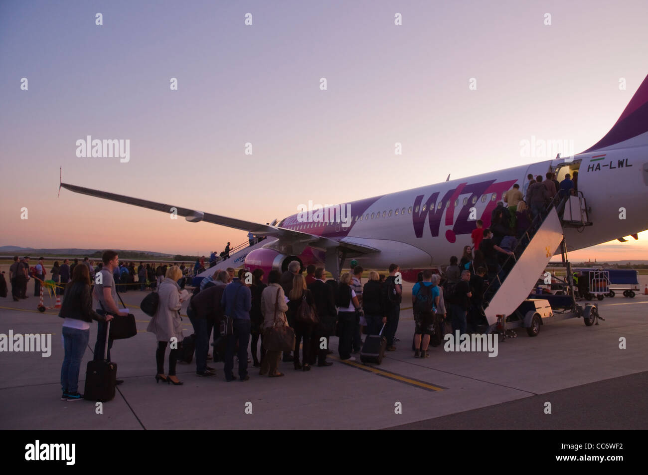 People getting on Wizzair airline aeroplane Letiste Brno the Brno airport Czech Republic Europe - Stock Image