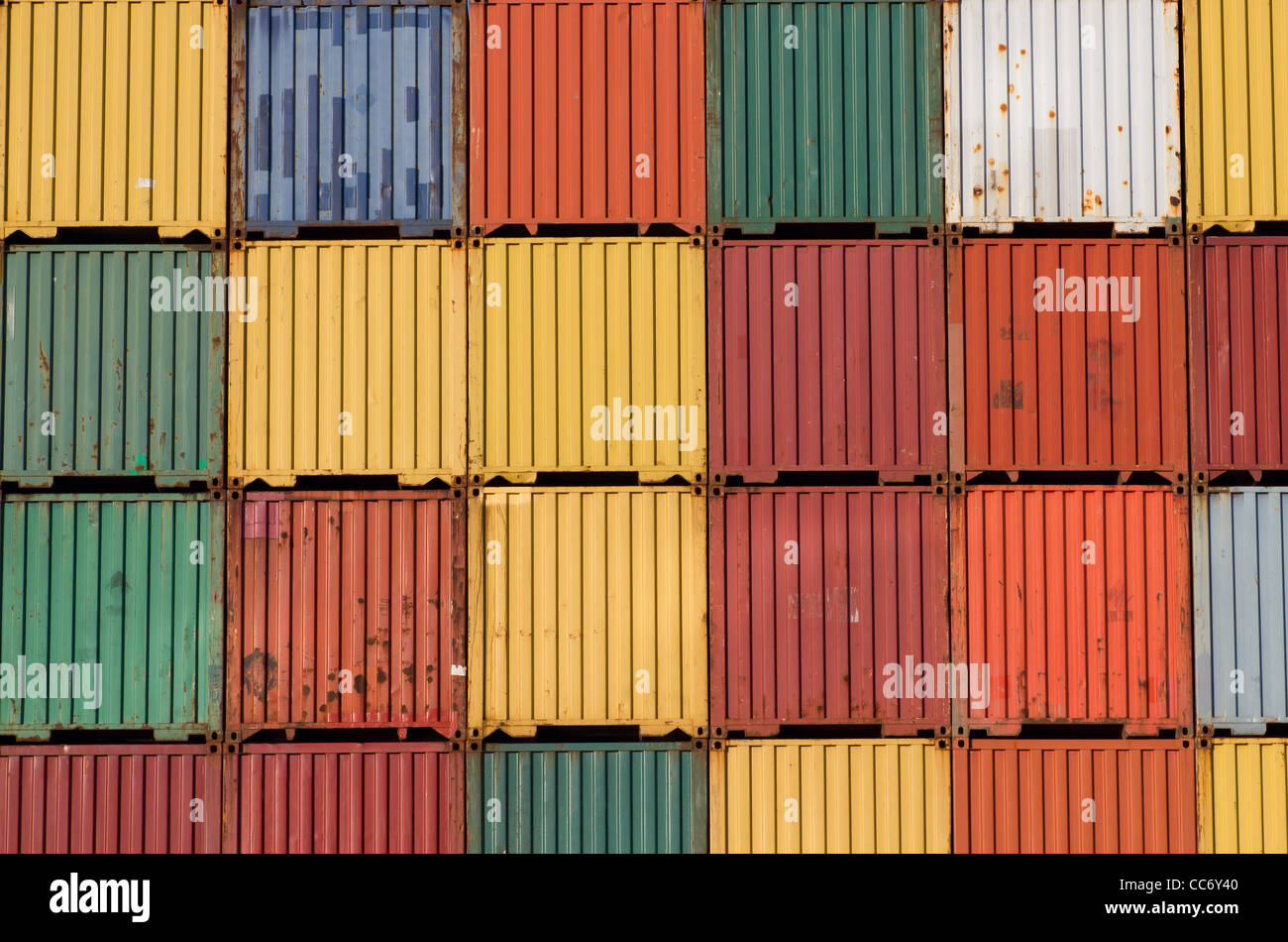 Lots of colourful ship cargo containers stacked up in a port. Stock Photo