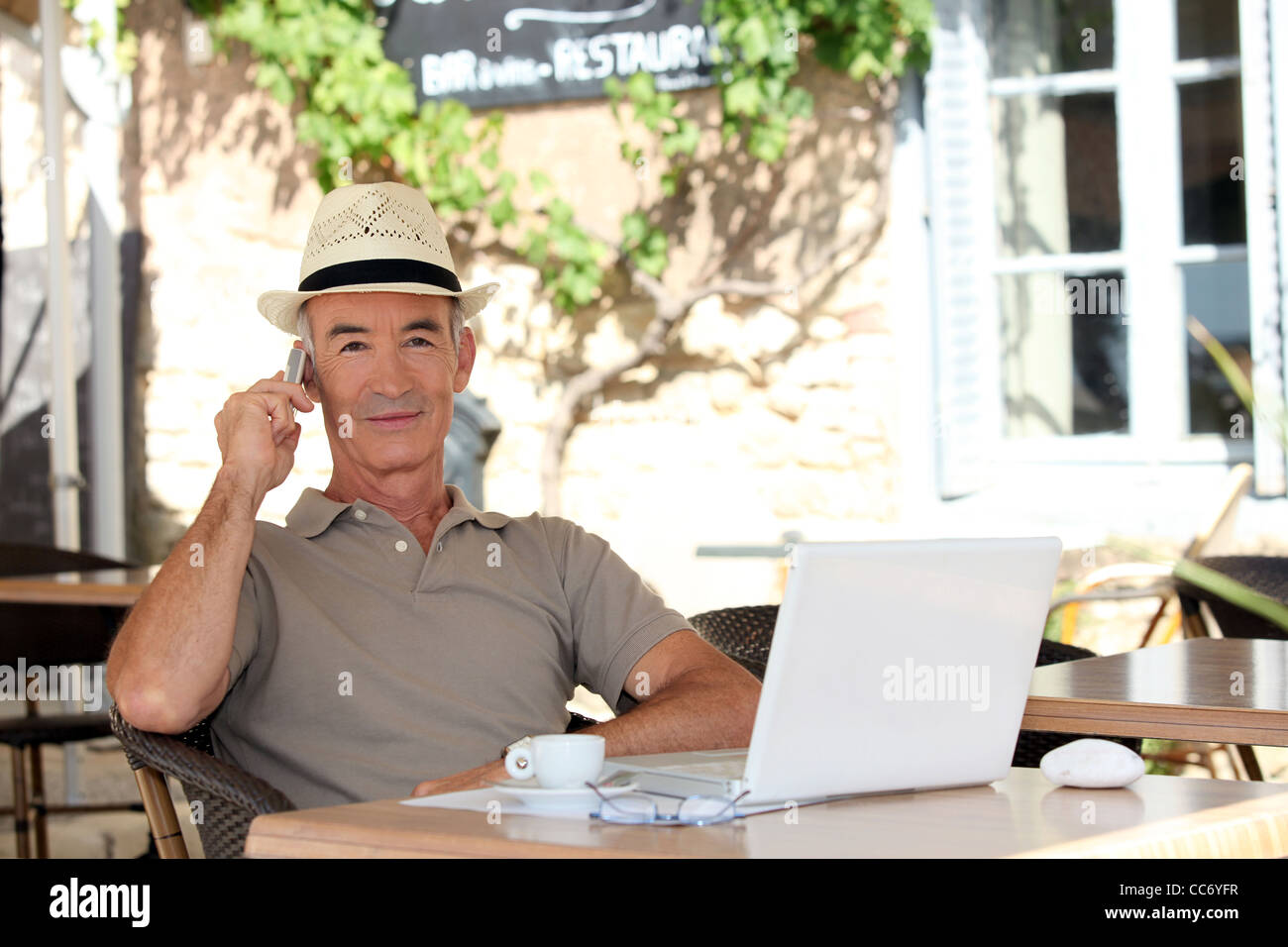 Man sitting on a terrace - Stock Image