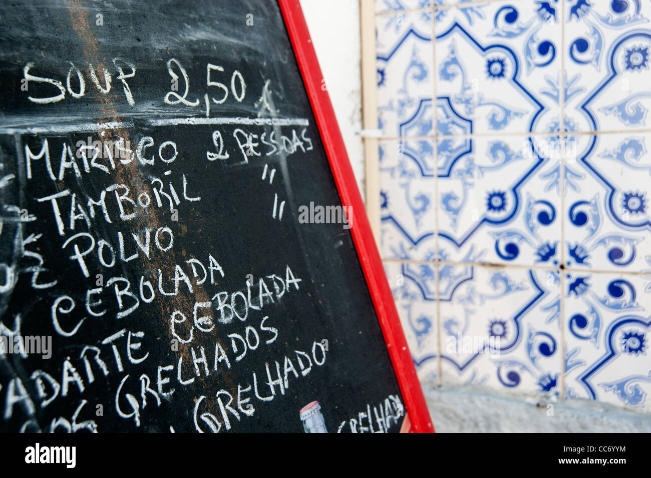 Azulejos, tiles and menu card in the town of Tavira, eastern Algarve, Portugal, Europe. - Stock Image