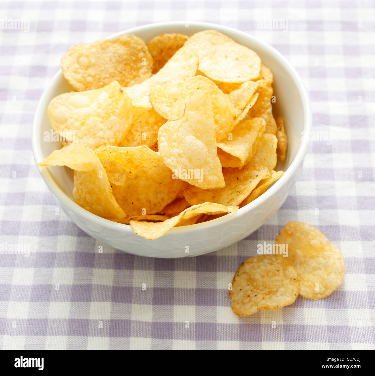 Chips in a bowl - Stock Image