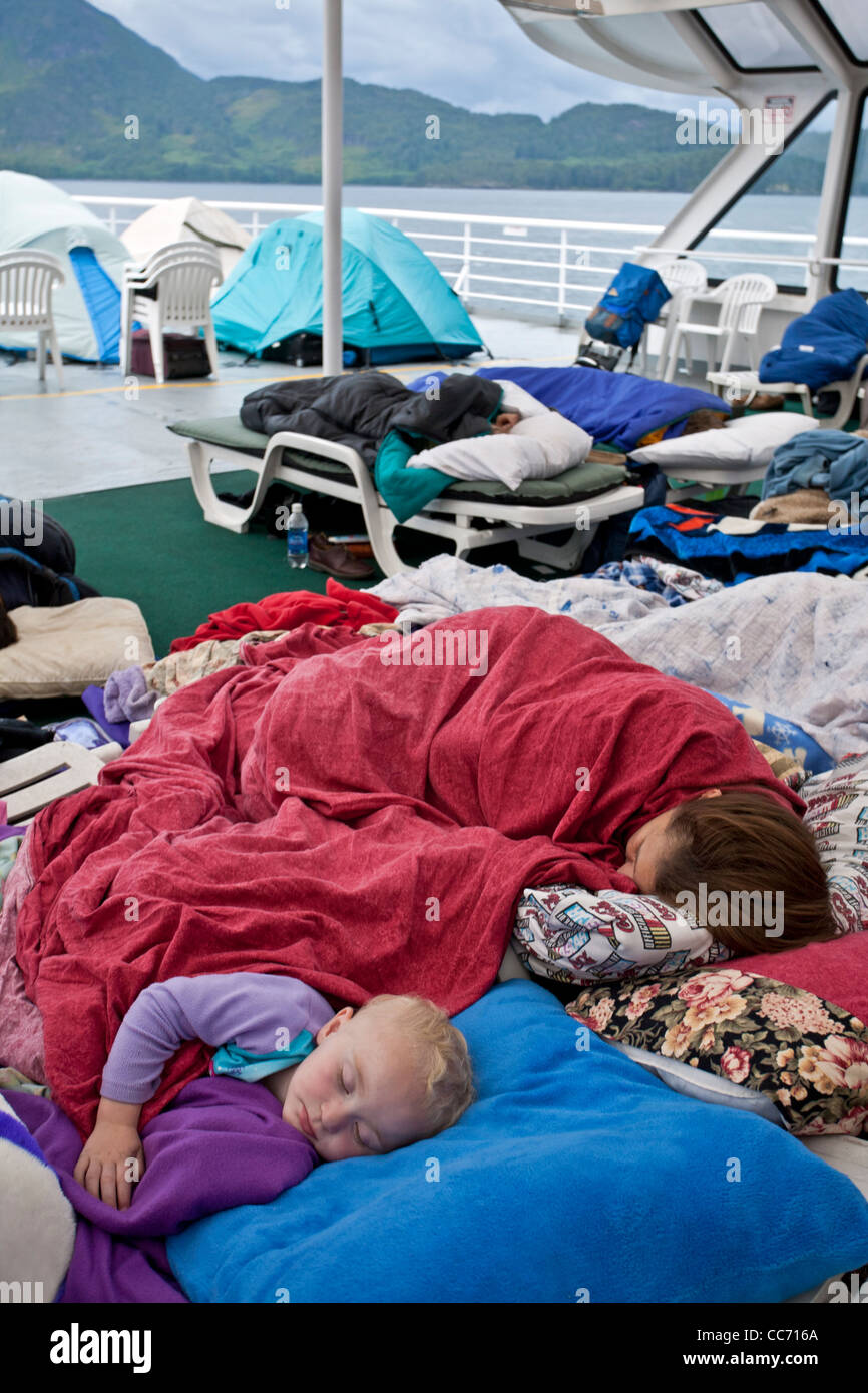 Family sleeping on the deck of the ferry from Bellingham