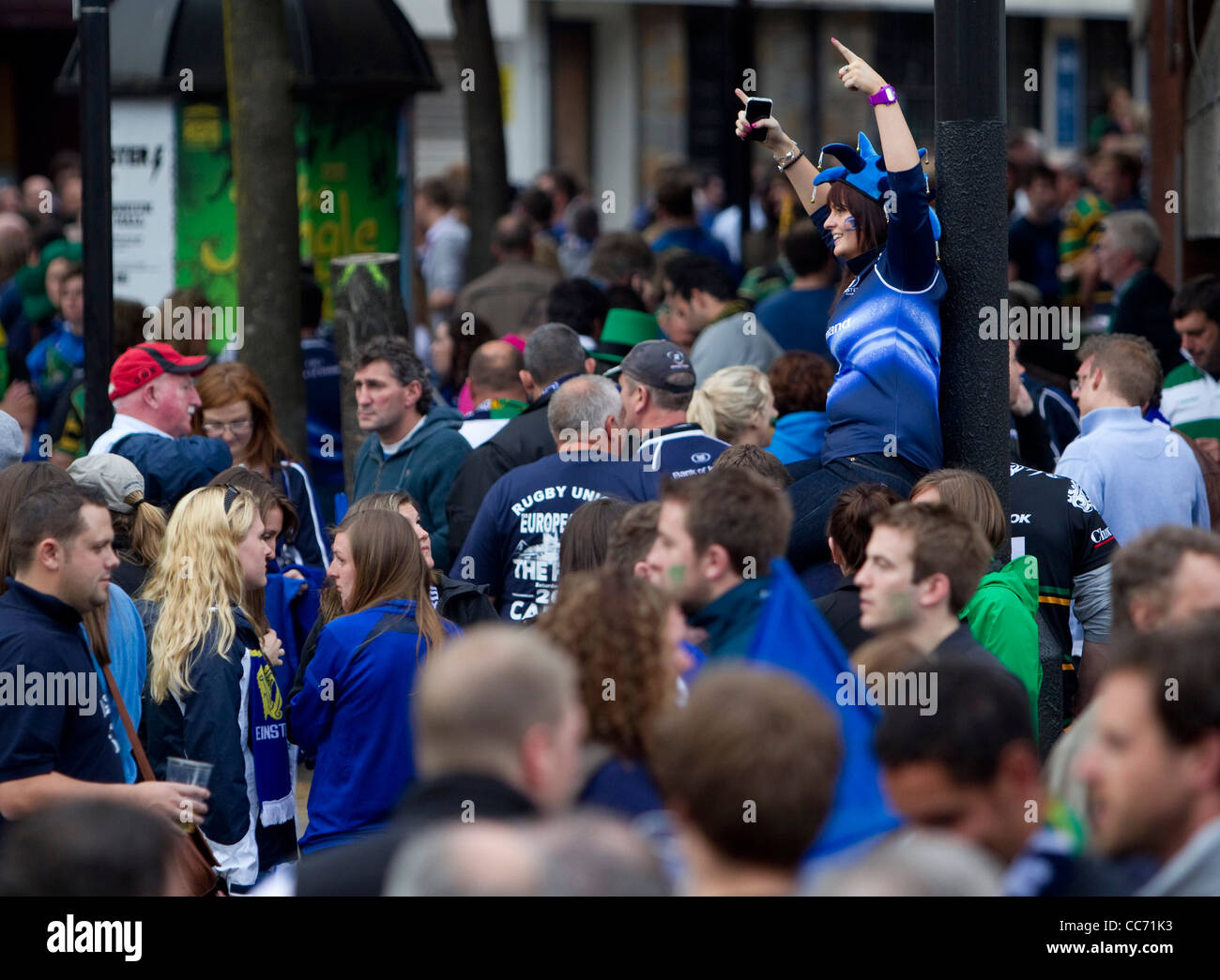 Leinster fans celebrate their side's win over Northampton to be crowned Heineken Cup Champions. Stock Photo