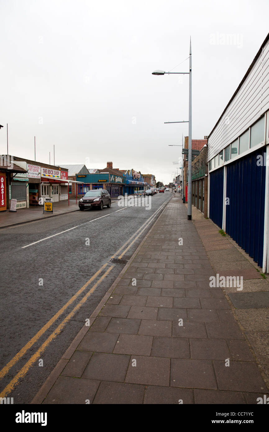 East coast, Mablethorpe, Lincolnshire amusements arcades closed on High Street promenade shoppers and tourists - Stock Image