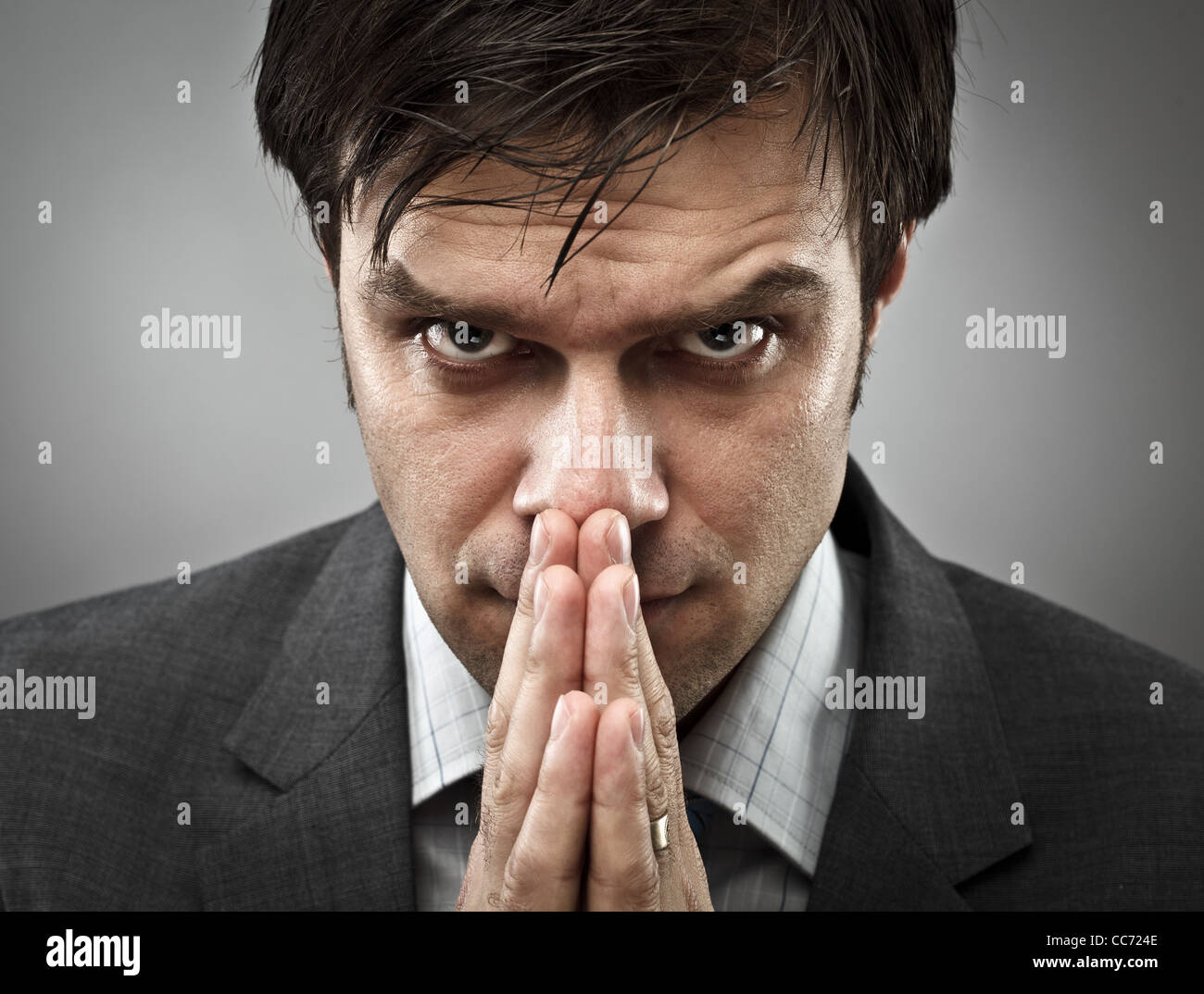 Young businessman with an expression of intense concentration - Stock Image