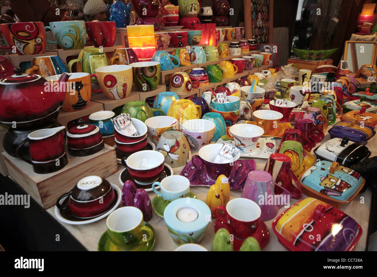 CUPS SAUCERS & BUTTER DISHES IN STALL KRAKOW POLAND 25 December 2011 - Stock Image