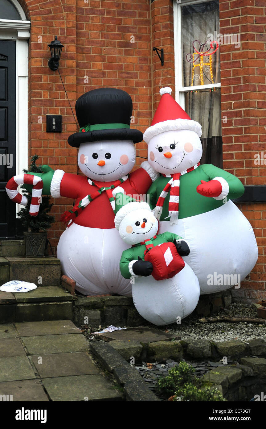 inflatable snowman santa family outside of private house stock image