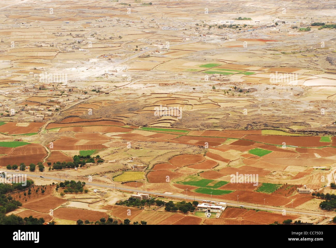 Yemen, Kowkaban, aerial view of farm fields, fallows, patchwork landscape with mountains in the background Stock Photo
