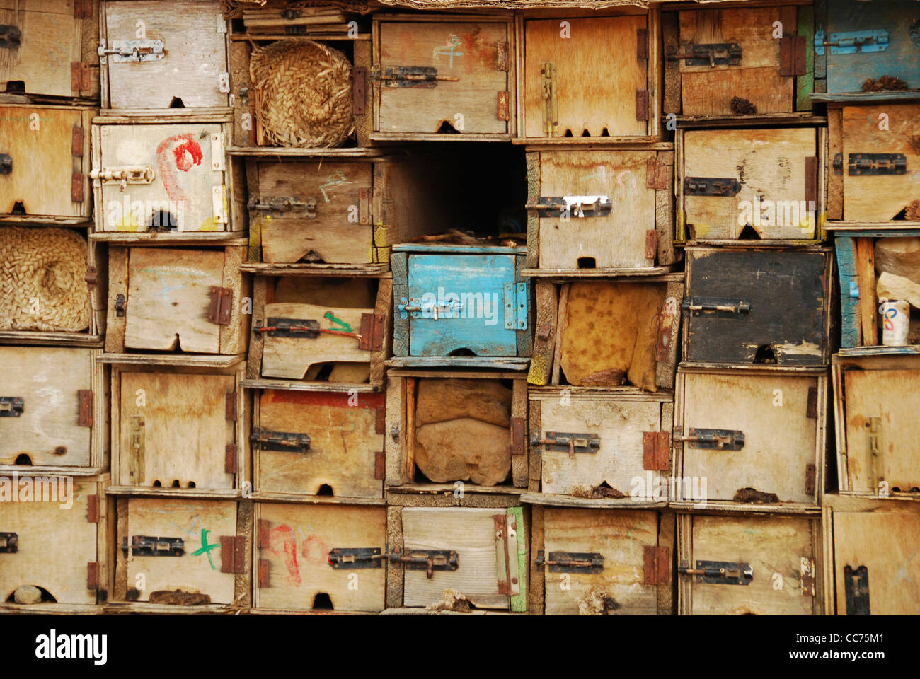 Yemen, inland, detail of weathered wooden boxes with blue colored box in between Stock Photo