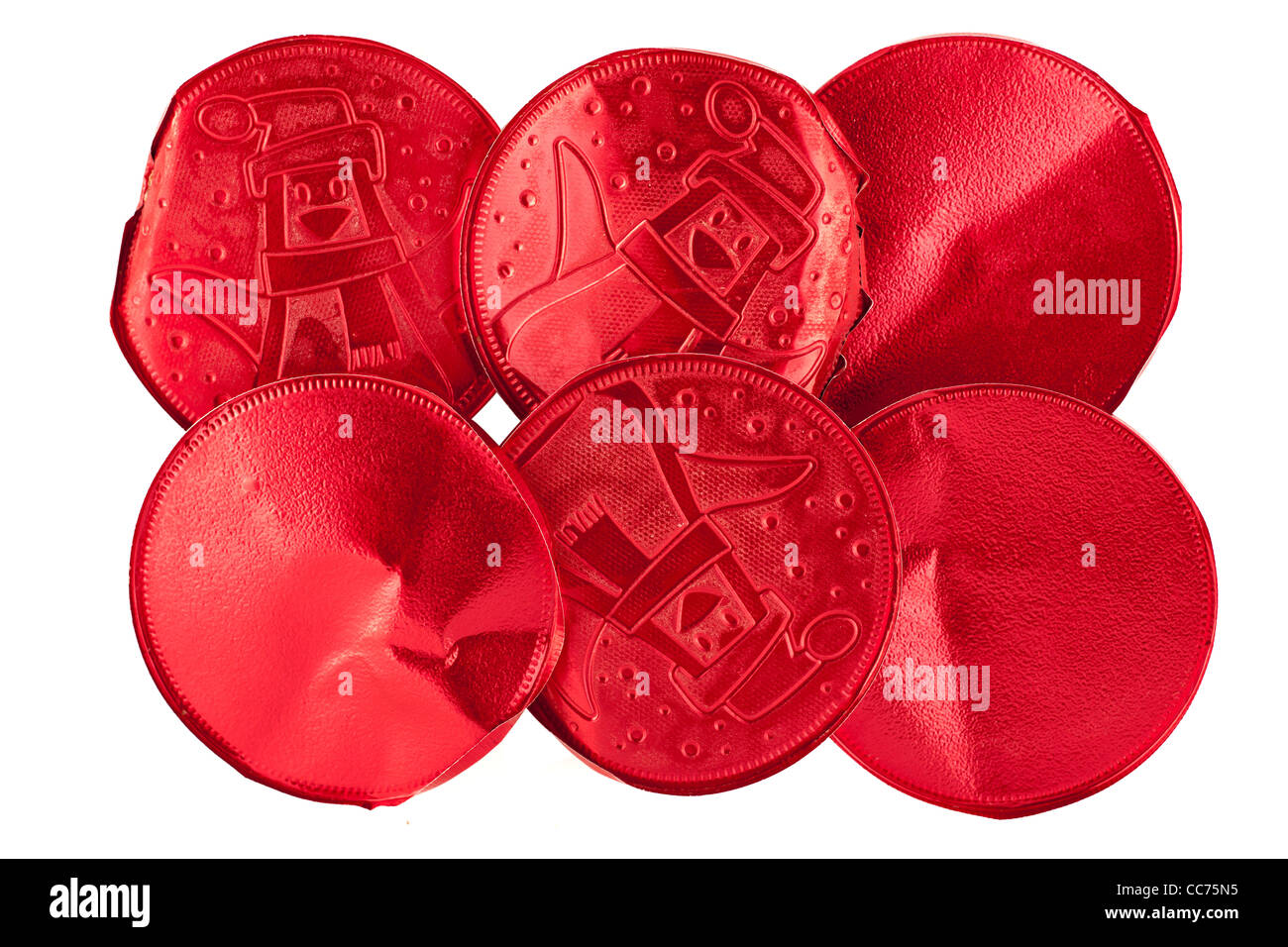 Circular red foil chocolate wrappers - Stock Image