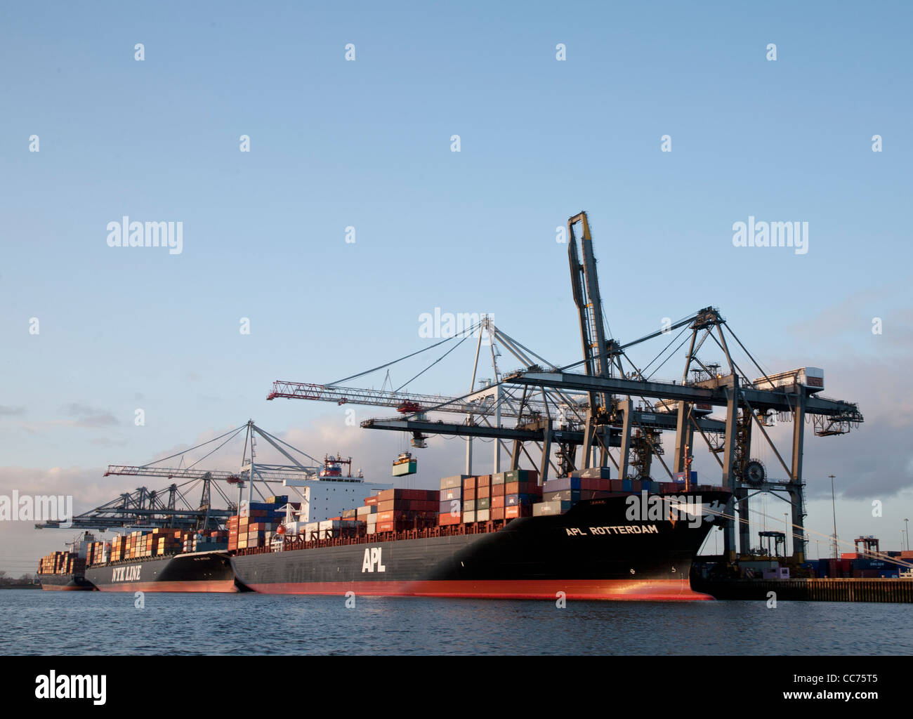 Container ships loading in the port of Southampton - Stock Image