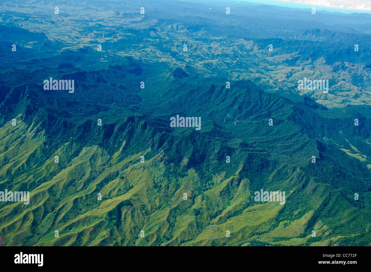 Fiji aerial green mountains deep valleys wide open empty space - Stock Image