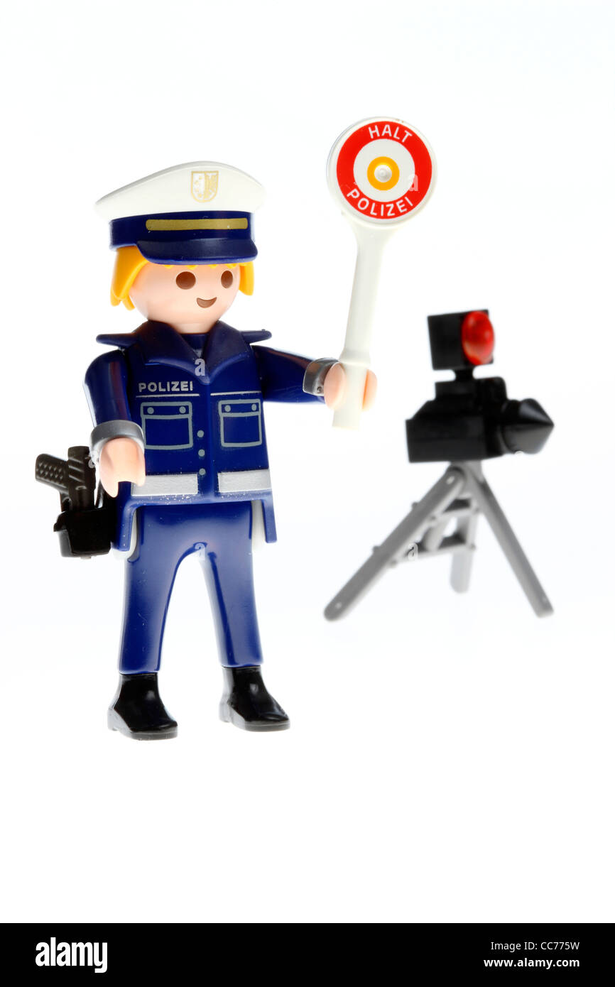 Stop police. Playmobil figure, toy. Police control, speed control, symbol picture. - Stock Image