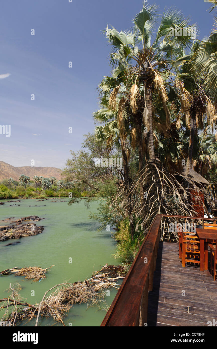 Kunene river near the Epupa Falls, seen from a terrace of a lodge.  Kaokoland, Namibia. - Stock Image