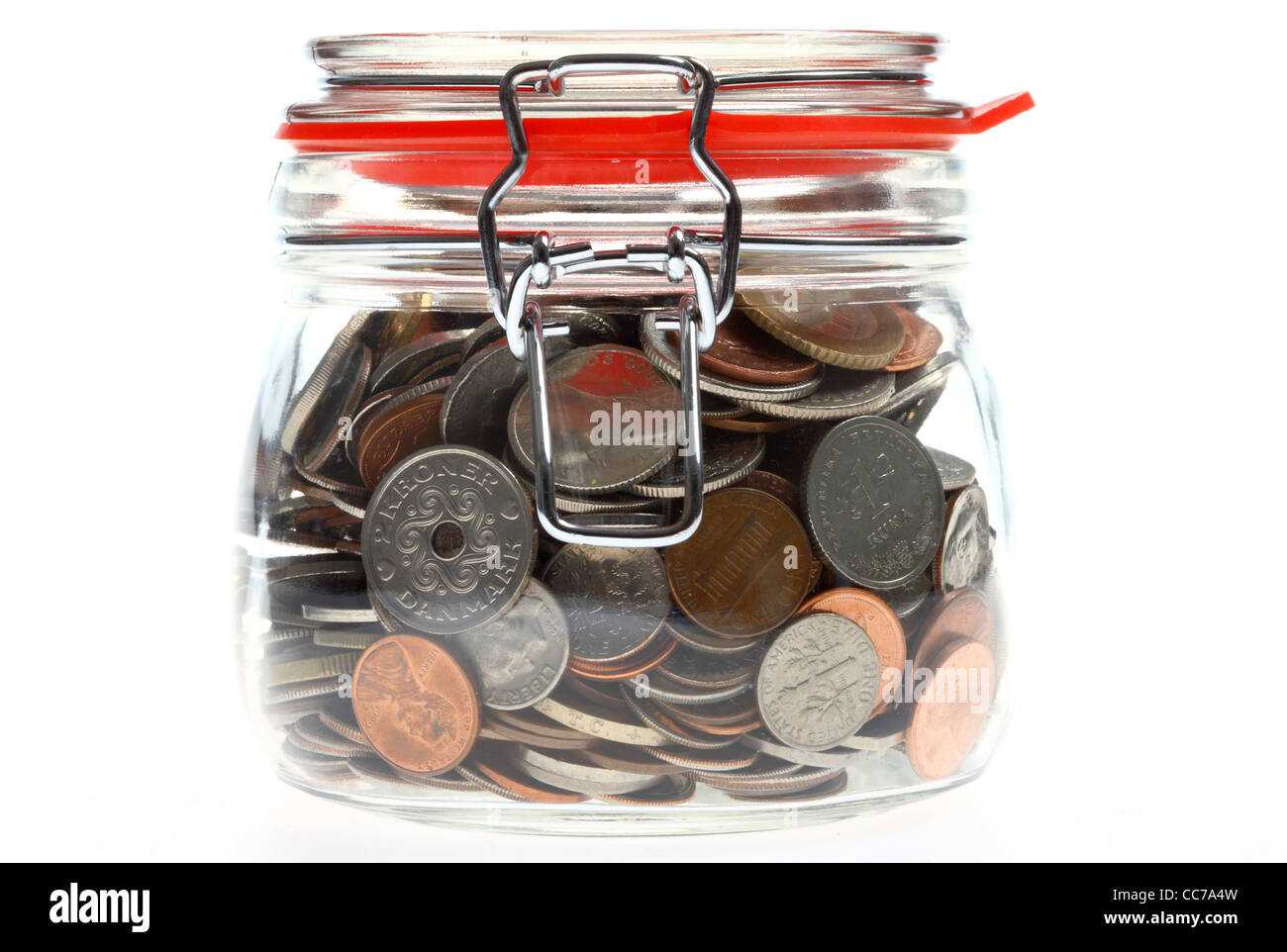 Money in a glass, preserving jar,  coins, different kinds of coins, from different country's, different currency's. - Stock Image