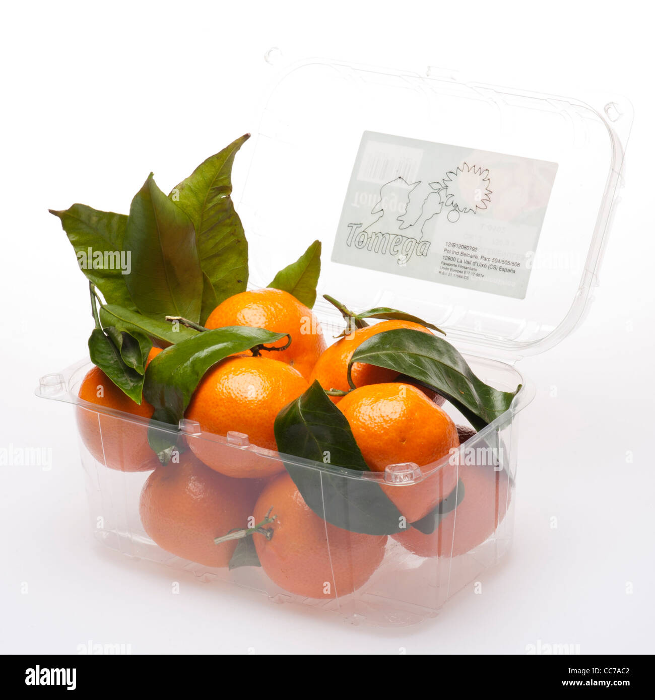 a plastic punnet of Clemantines oranges - Stock Image