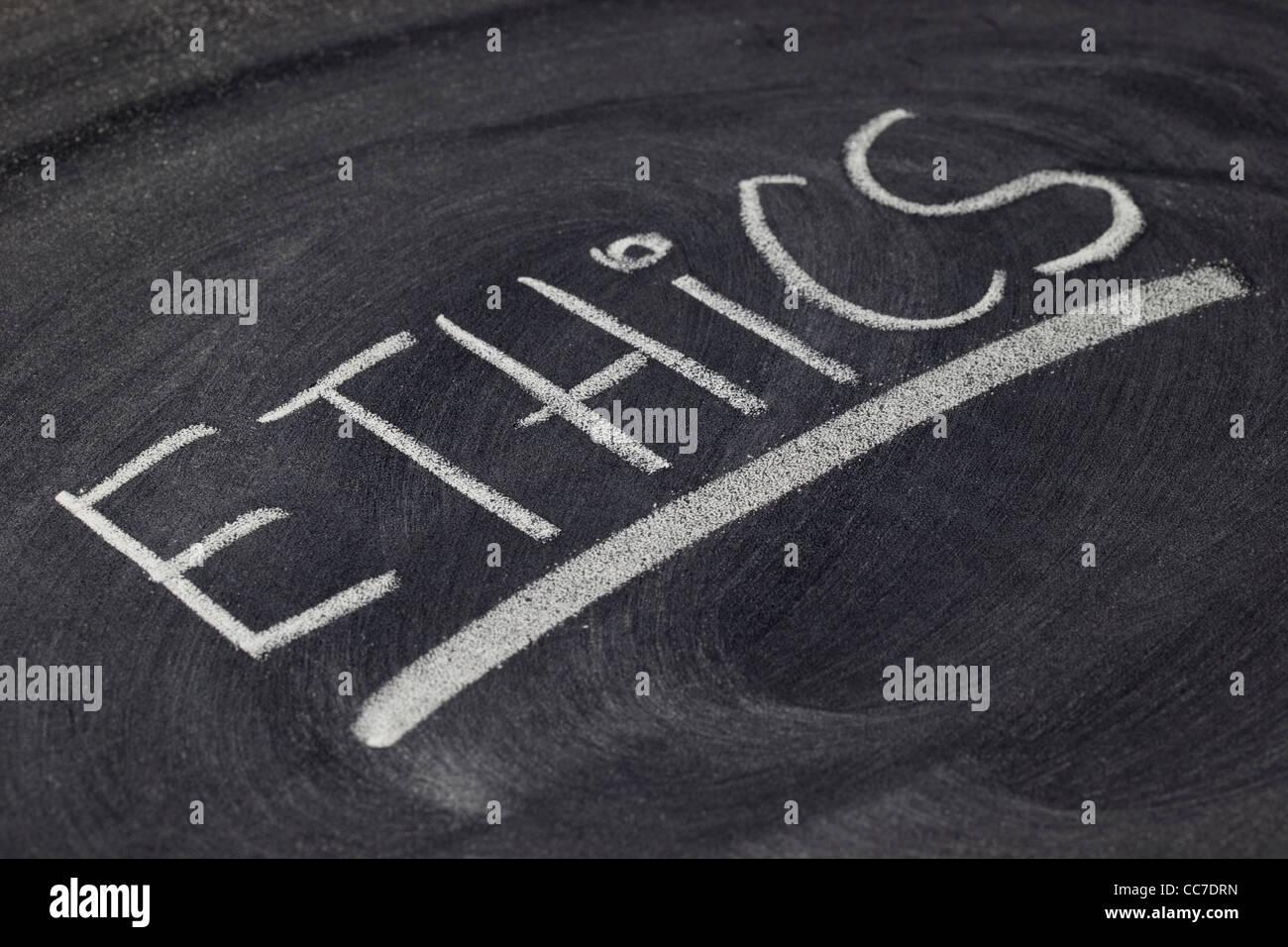 ethics word - white chalk handwriting on blackboard - Stock Image