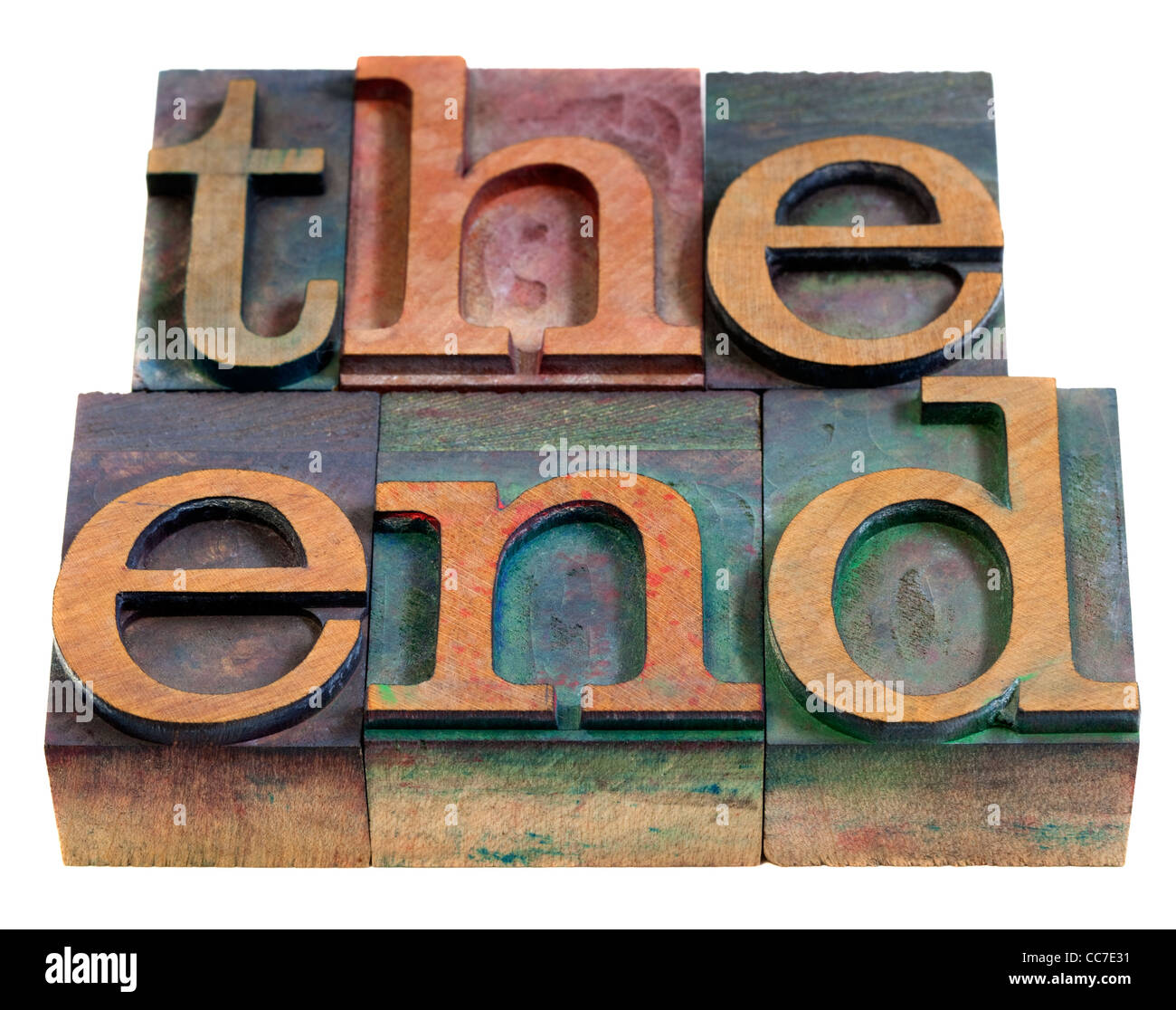 The end concept - words in vintage wooden letterpress printing blocks, stained by color inks, isolated on white - Stock Image