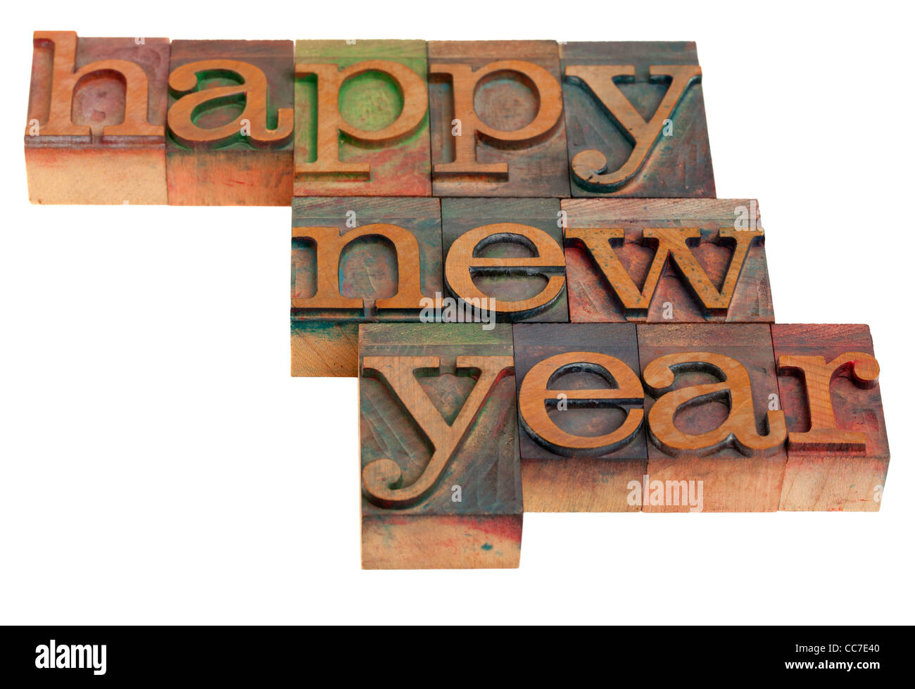 Happy New Year greetings in vintage wooden letterpress printing blocks, isolated on white - Stock Image