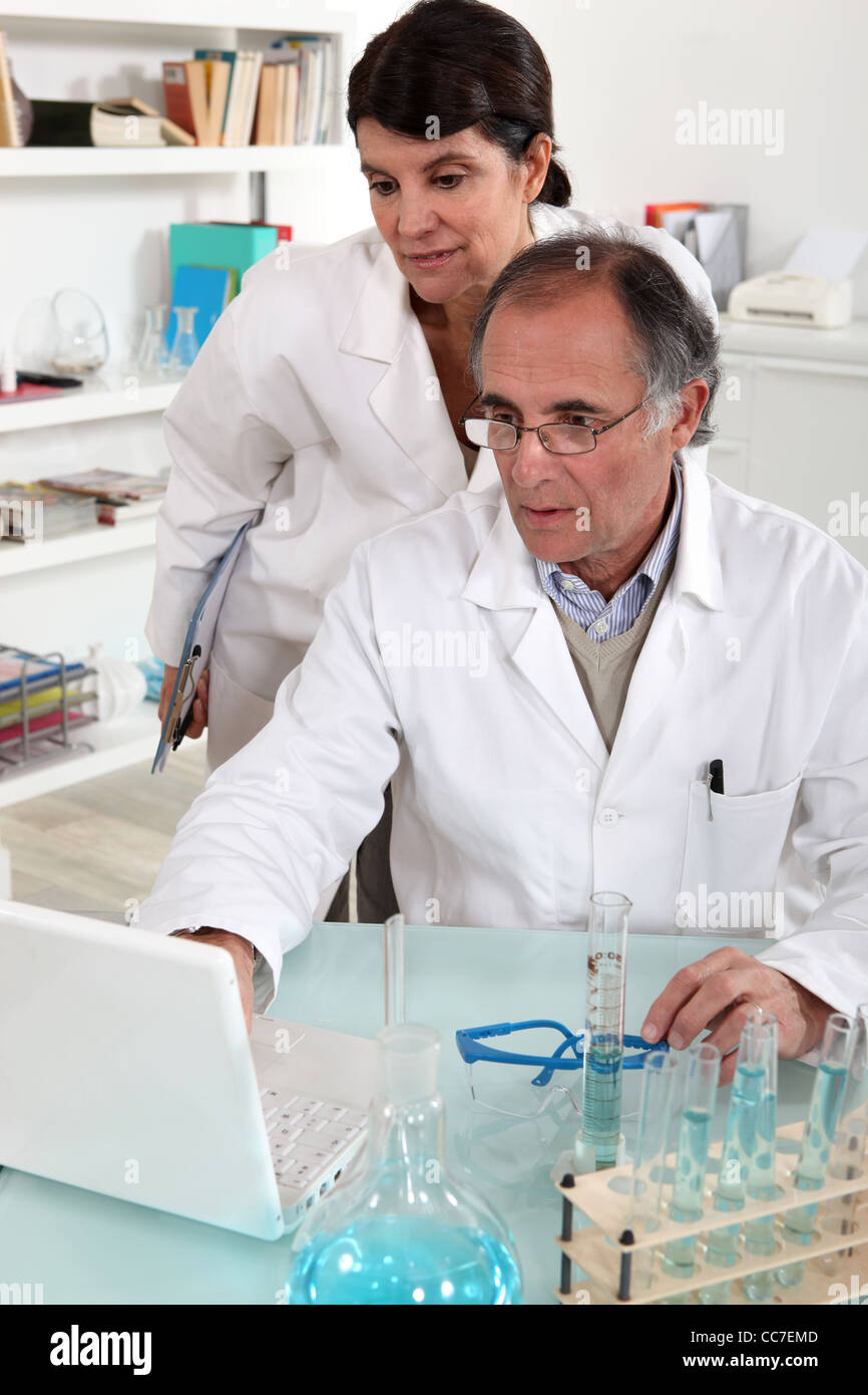 Scientists in a laboratory - Stock Image