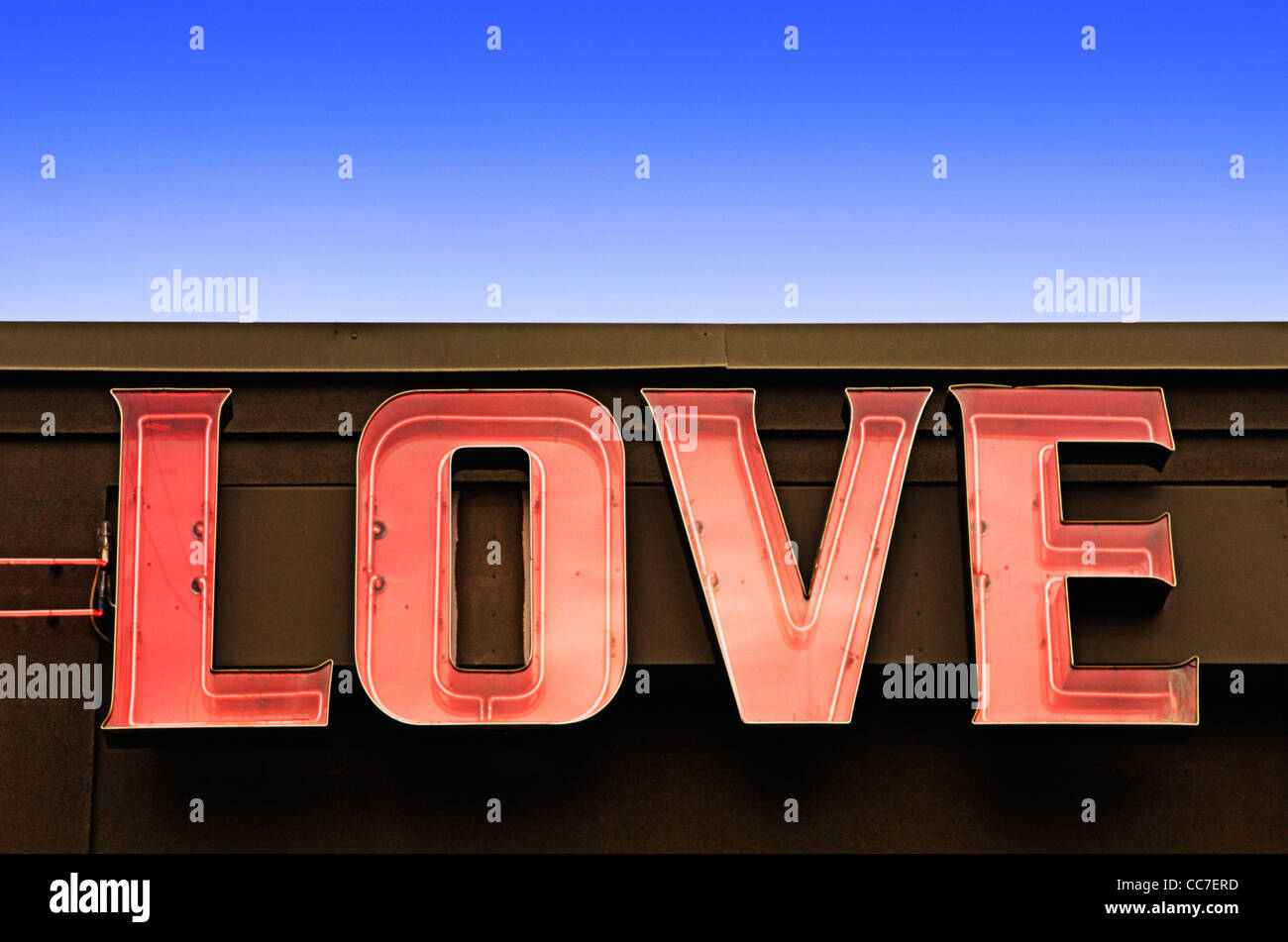 the word love mounted on wall of building - Stock Image