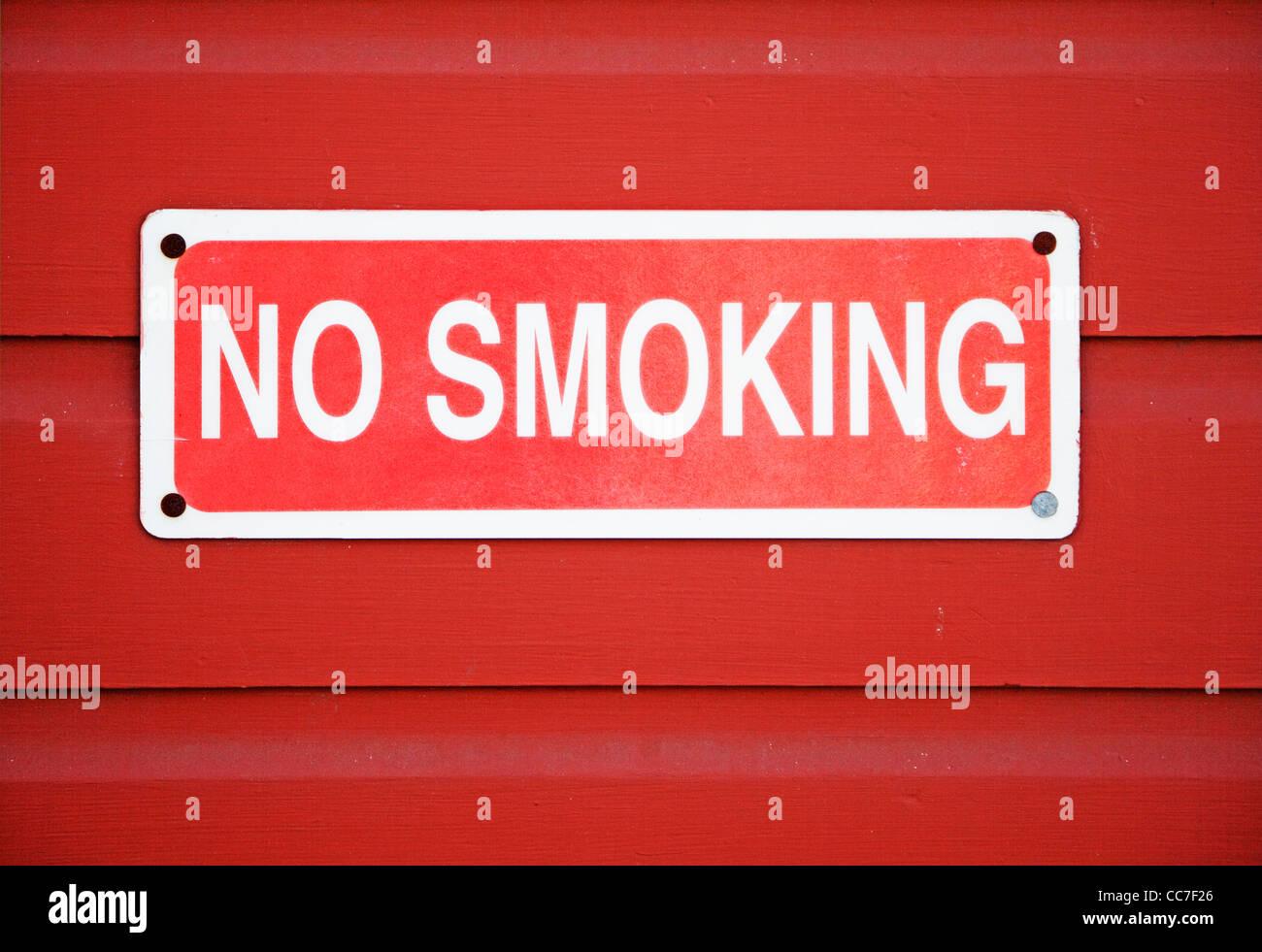 no smoking sign mounted on wall - Stock Image