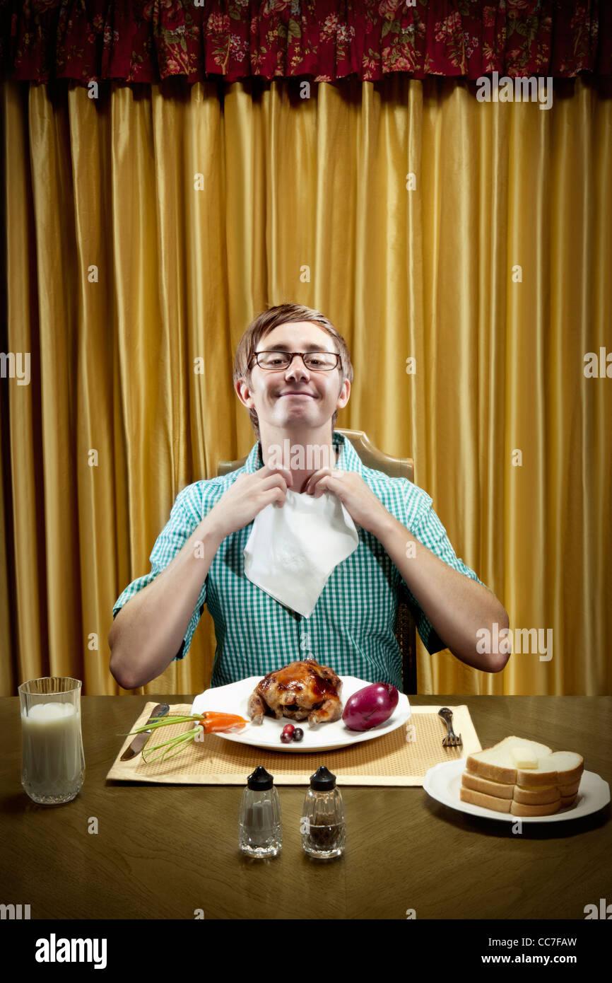 Caucasian man preparing to eat dinner Stock Photo