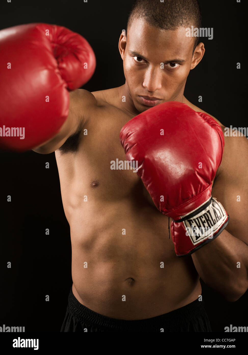 Boxer with red Everlast boxing gloves - Stock Image