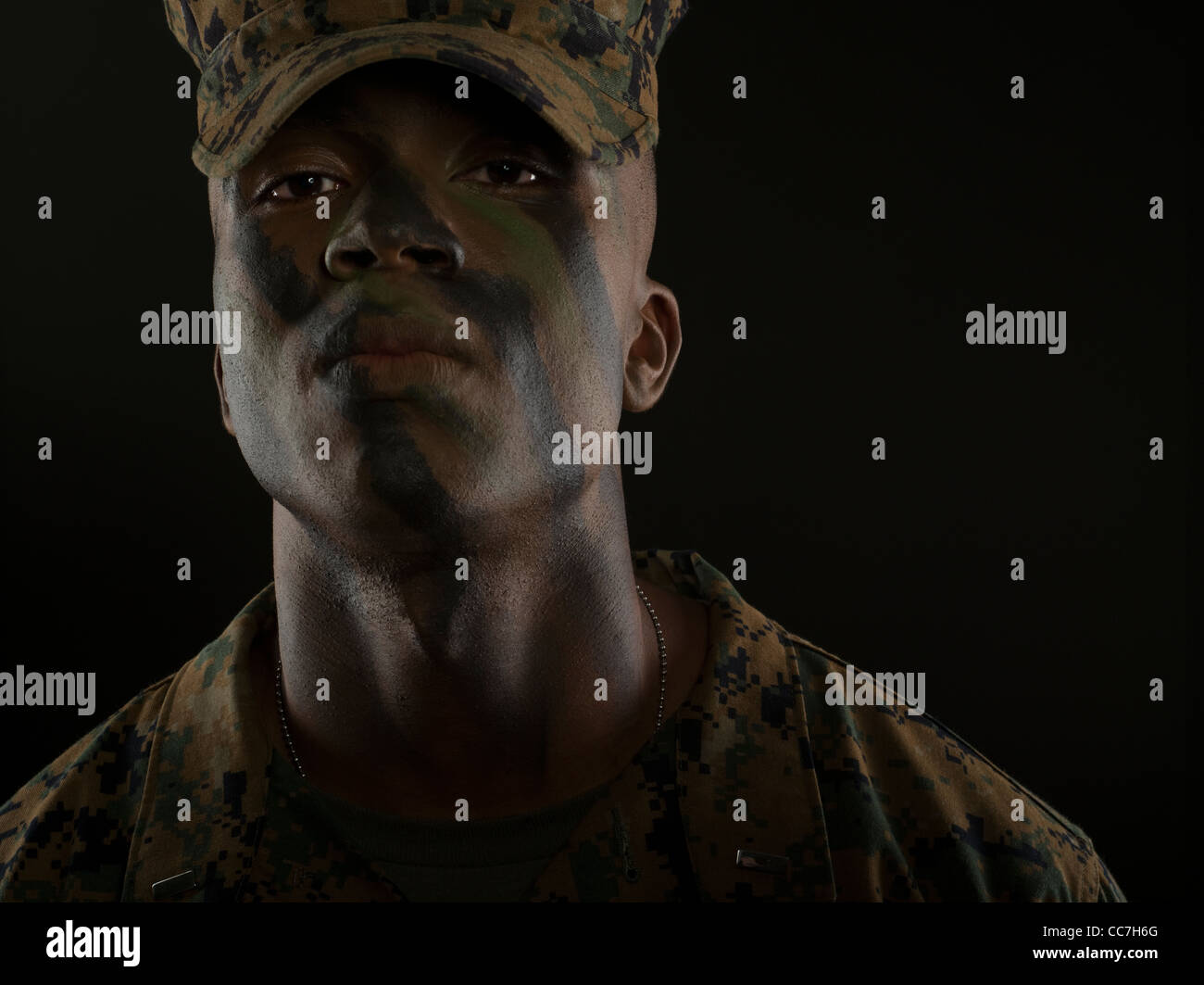United States Marine Corps Officer in MARPAT digital camouflage uniform and camo face paint - Stock Image