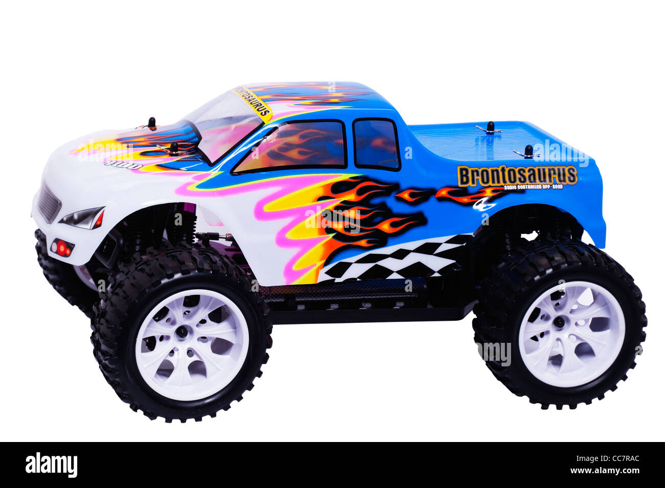 A radio controlled Brontosaurus off road buggy car on a white background - Stock Image