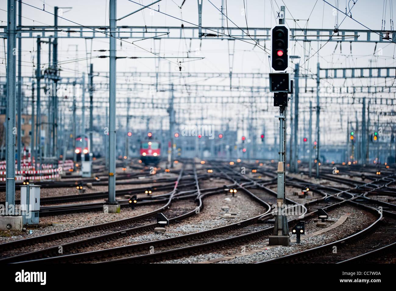 Railway lines at Zuerich main station vanishing into distant blur (low dof), Zuerich Switzerland - Stock Image