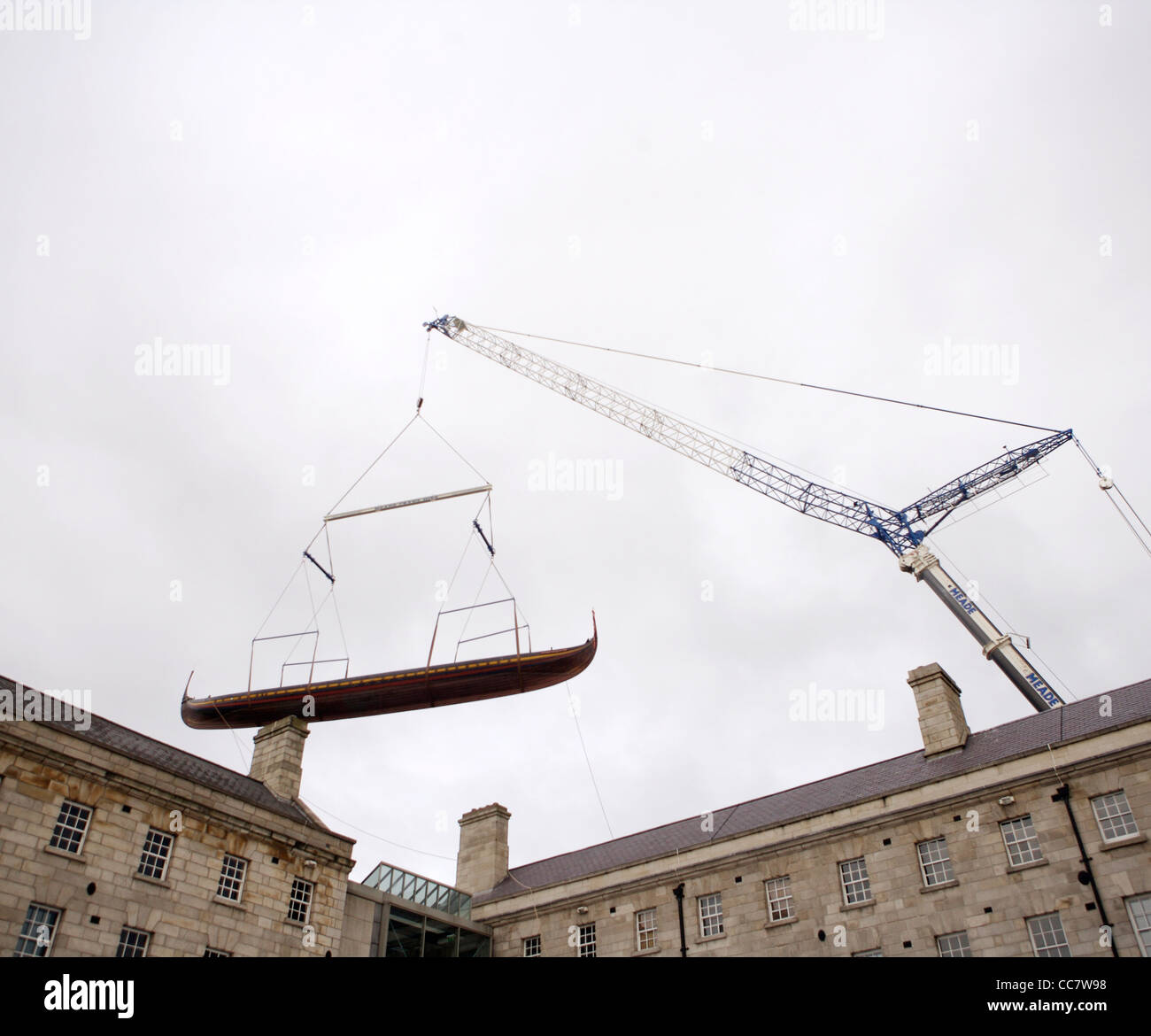 'Sea Stallion' replica viking ship lifted into the courtyard of Collins Barracks Museum, Dublin Ireland - Stock Image