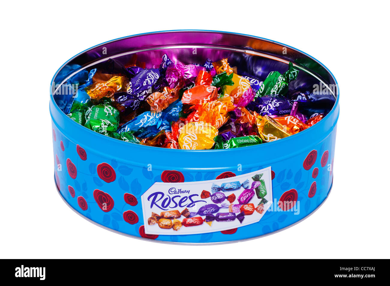 A tin of Cadbury Roses assorted chocolates on a white background - Stock Image