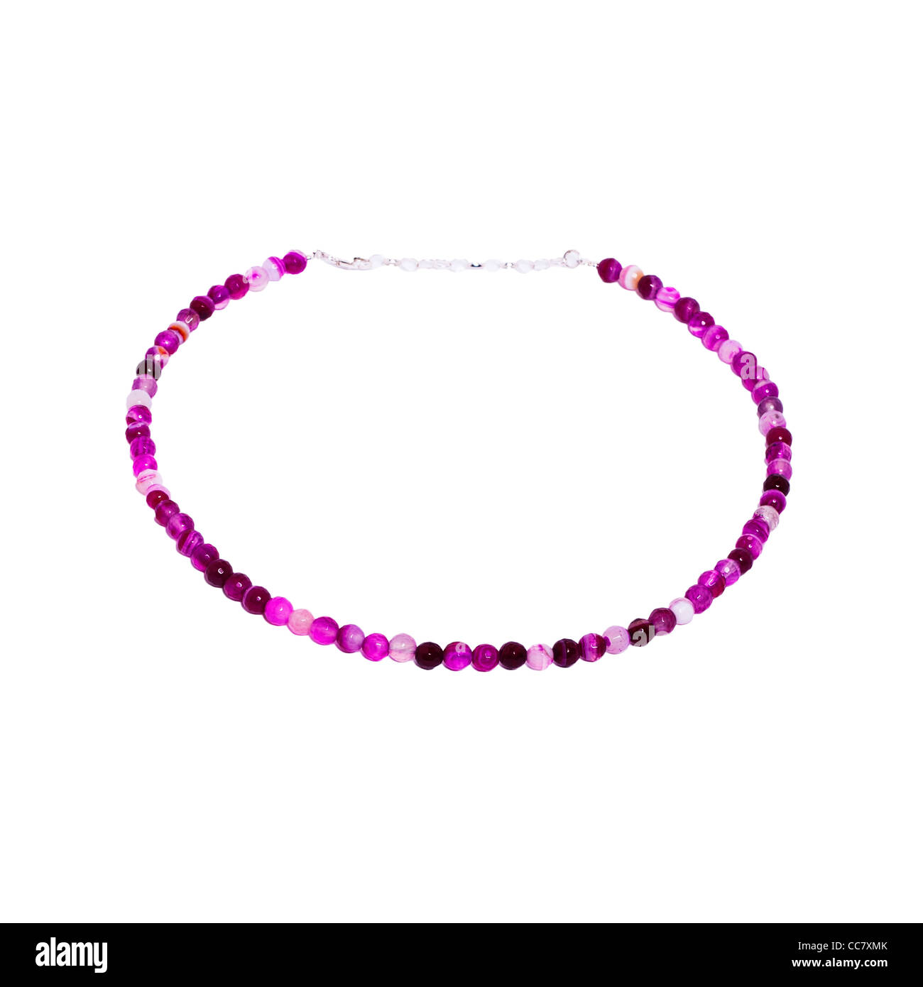 A bead necklace on a white background - Stock Image