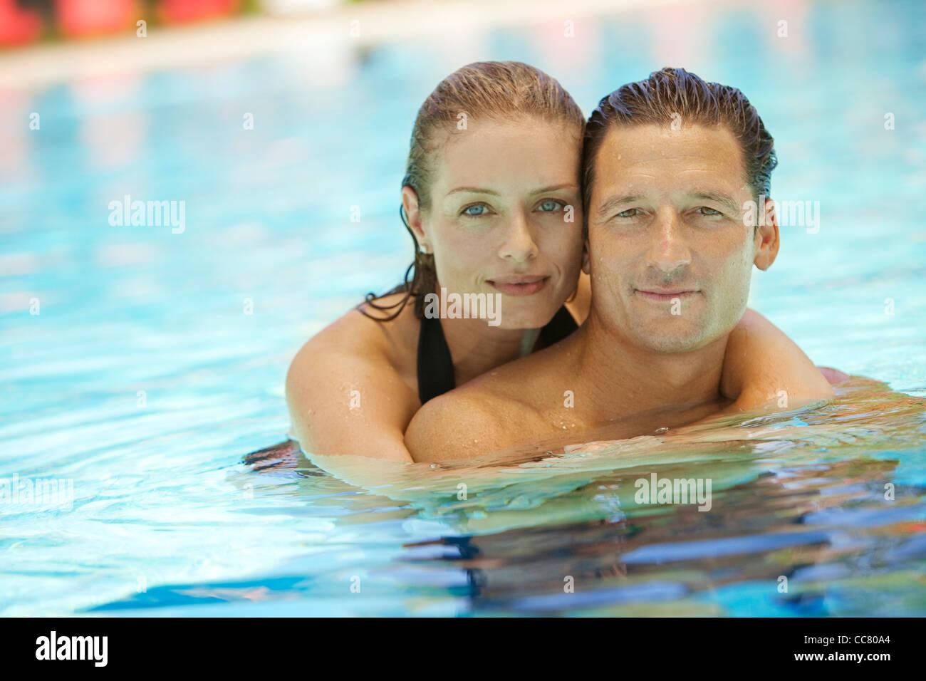 Portrait of Couple in Pool, Palm Beach Gardens, Florida, USA Stock Photo
