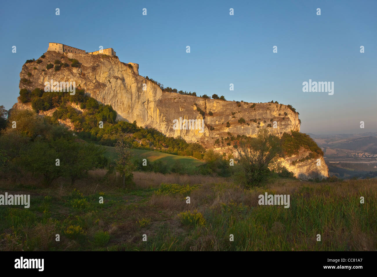 The Fortress, a castle on rocky crag, at sunrise at village of San Leo, Emilia-Romagna, Italy, AGPix_1992 - Stock Image
