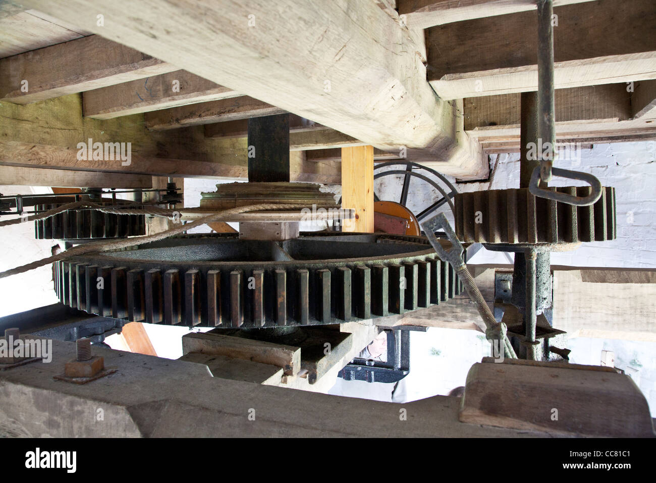 Machinery inside Wilton Windmill, a tower mill and the only working windmill in Wessex, at Great Bedwyn, Wiltshire, - Stock Image