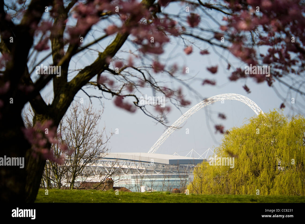 Wembley stadium seen in spring through the trees of Brent River Park in Brent a London borough - Stock Image