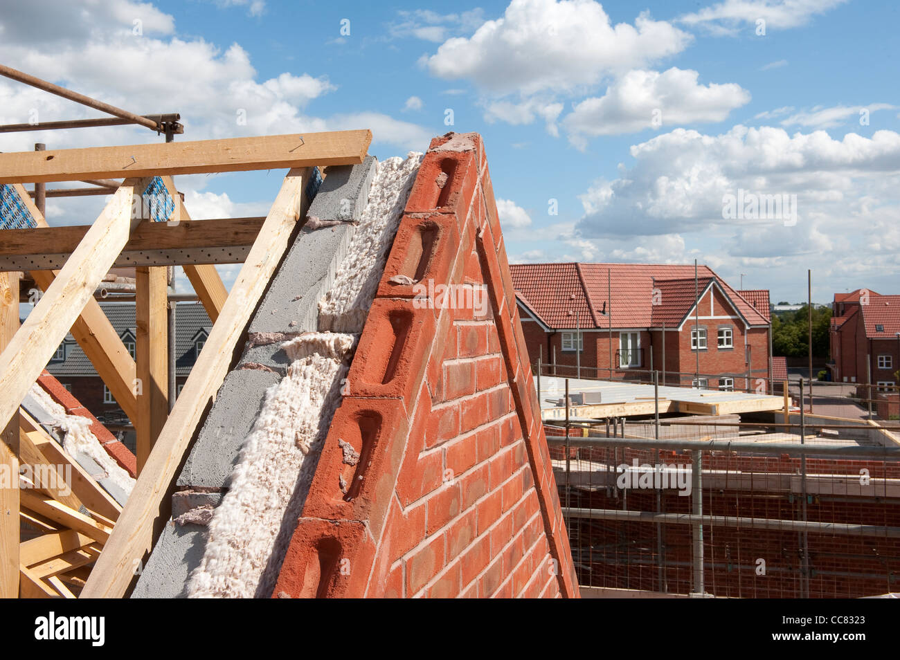 Brand new wooden roof timbers and insulation on a newly built house, England. - Stock Image