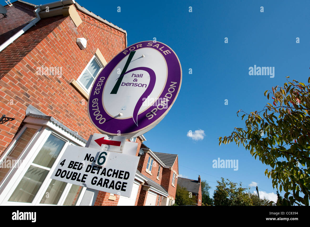 Estate agents for sale sign outside a house in England. - Stock Image