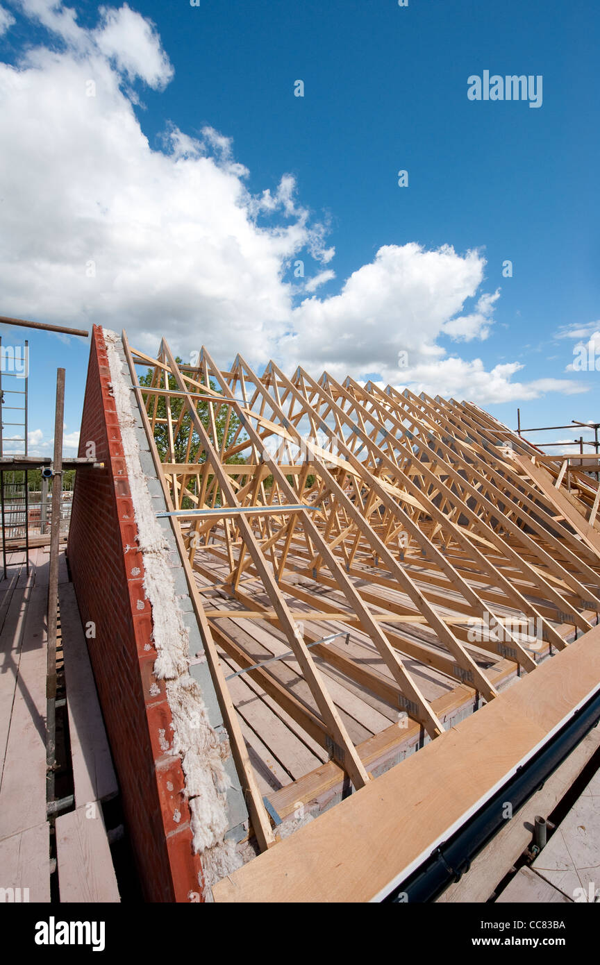 Brand new wooden roof timbers on a newly built house, England. - Stock Image