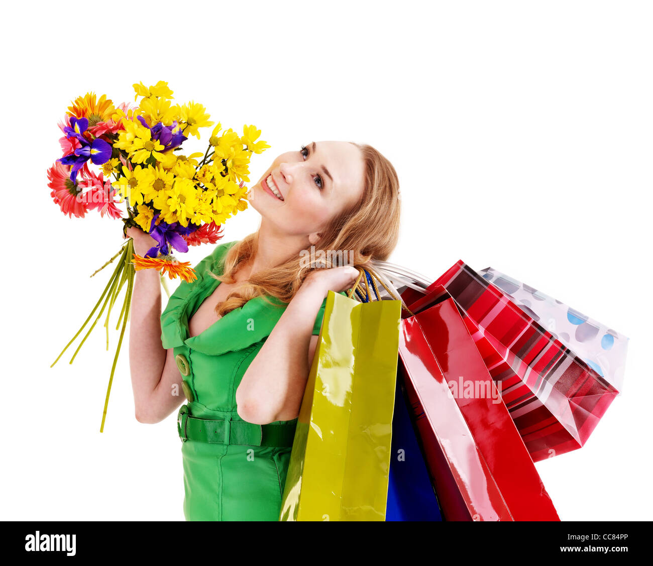 Young woman with shopping bag and flowers. Stock Photo