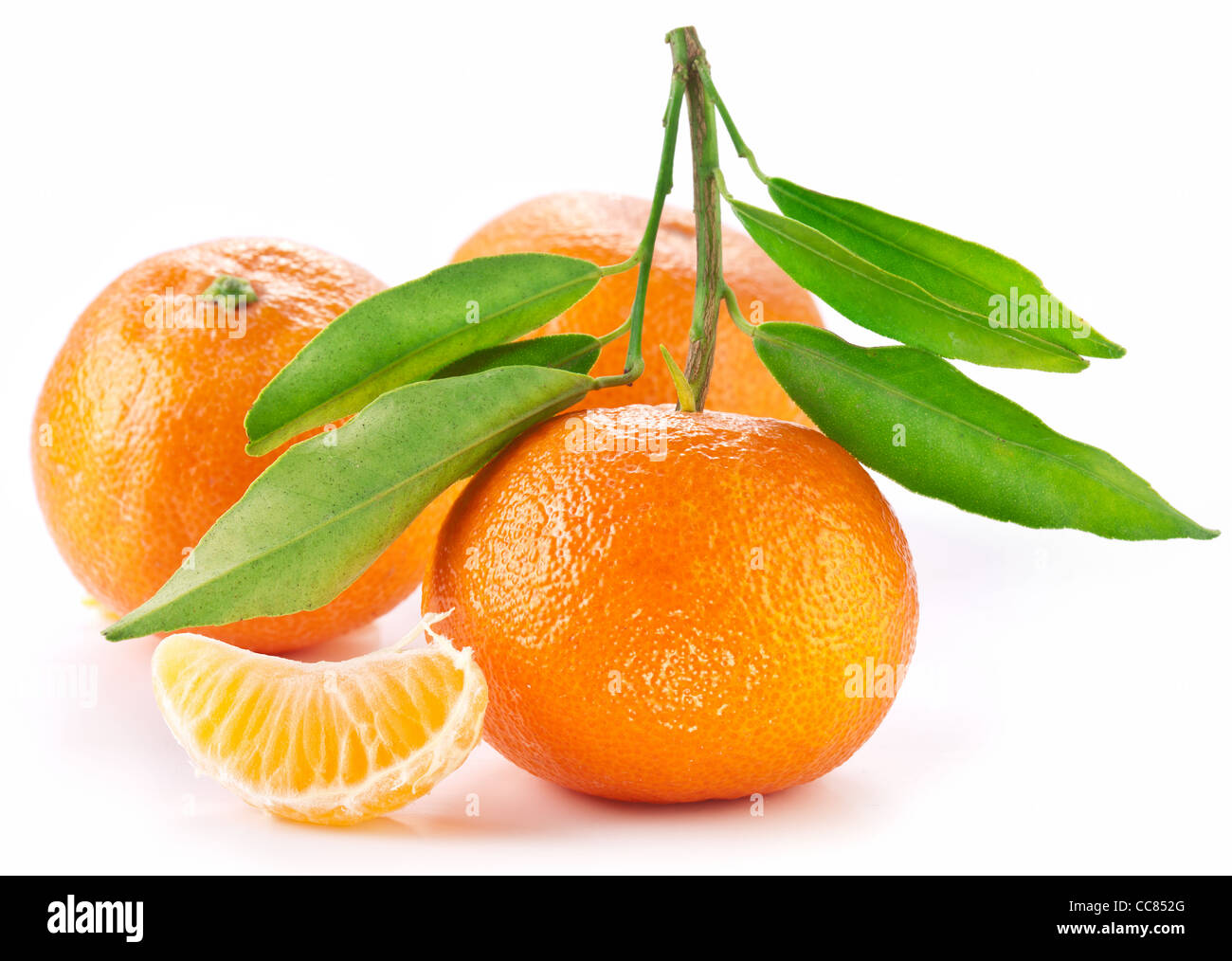 Tangerines with leaves on white background. - Stock Image