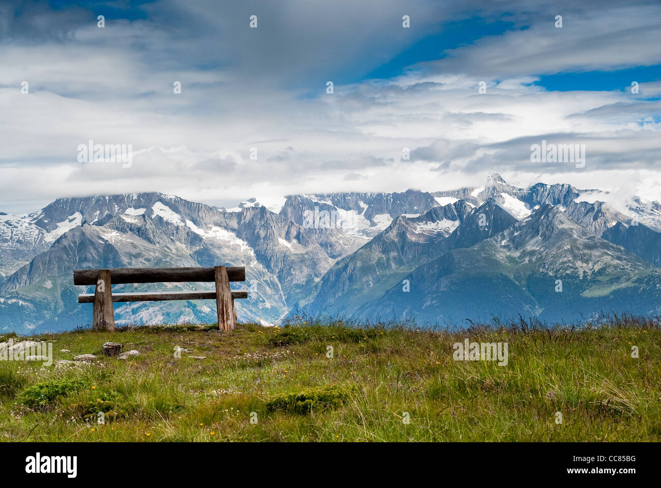 Empty park bench in high mountains, view from Hannigalp, Wallis, Switzerland - Stock Image