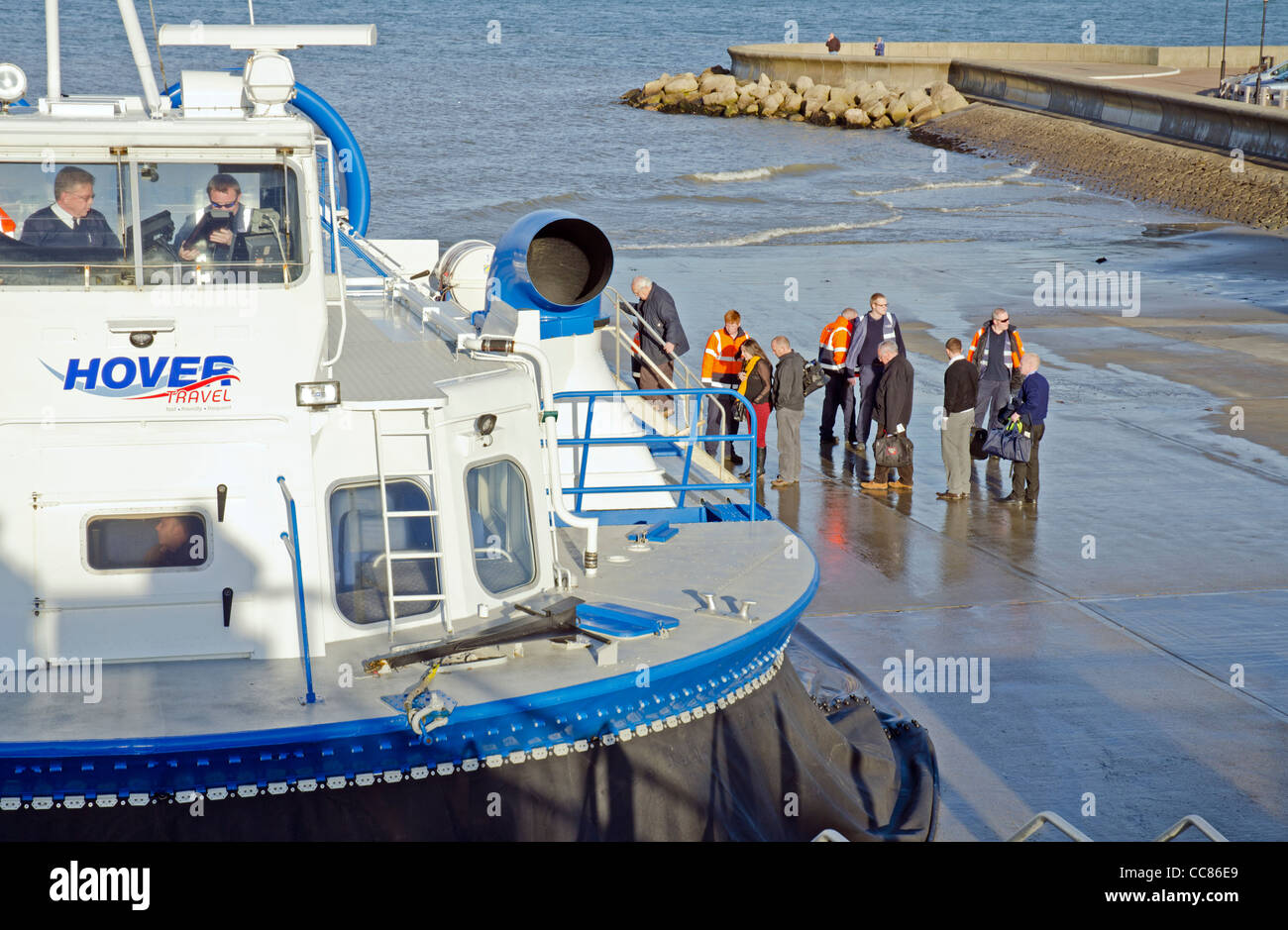 Passengers boarding a Hovertravel hovercraft on the slipway at Ryde, Isle of Wight, England, UK. - Stock Image