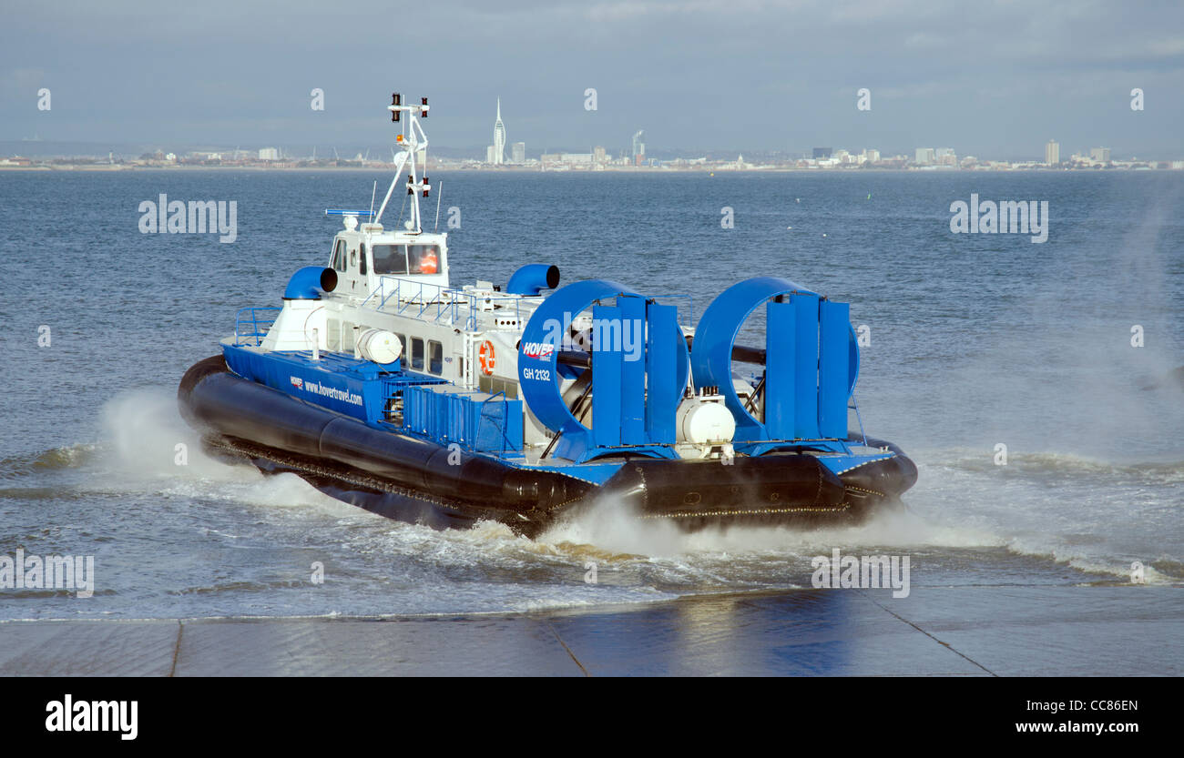 Hovertravel hovercraft speeding away from the slipway and crossing the Solent sea at Ryde on the Isle of Wight, - Stock Image