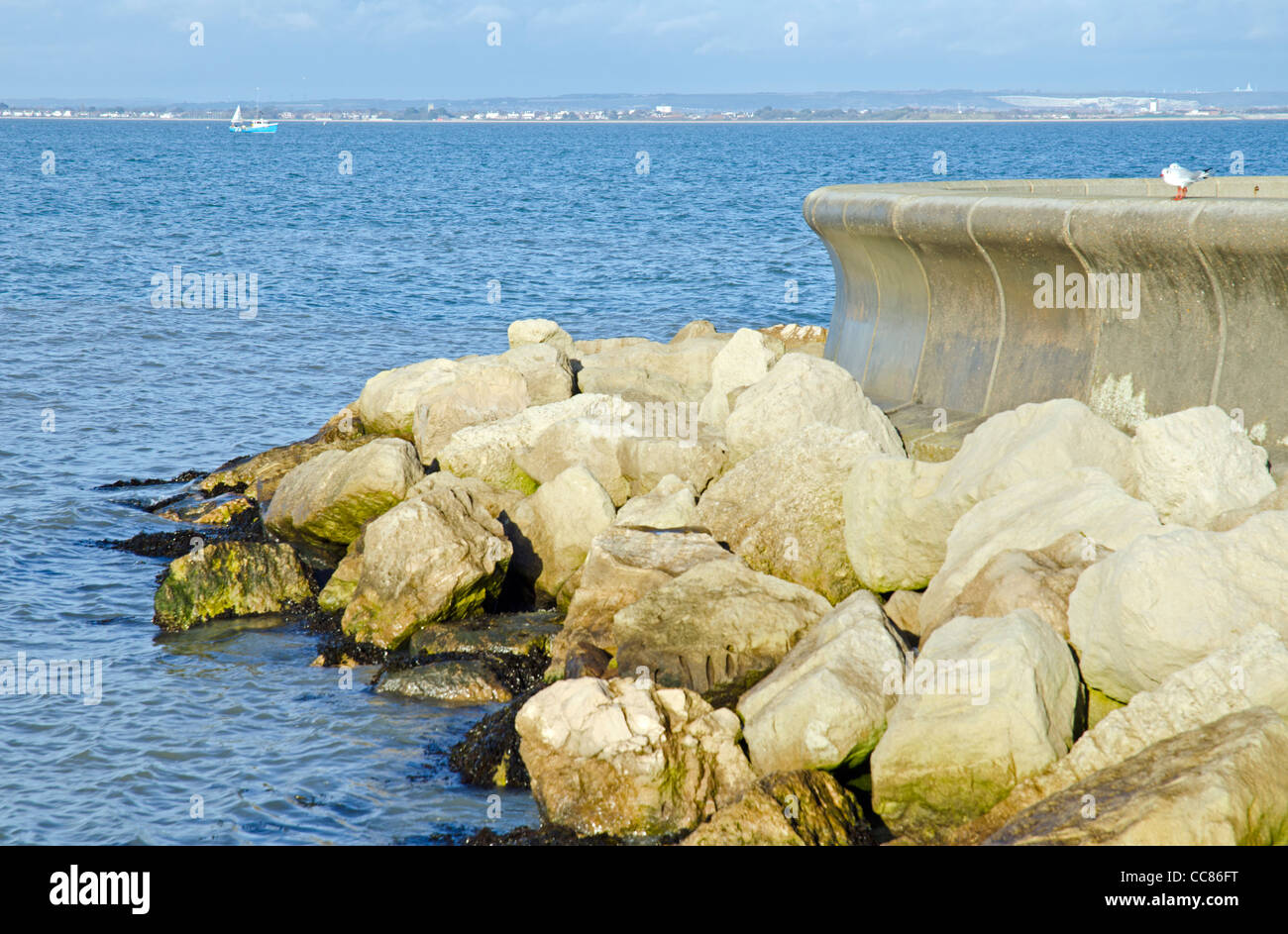Rocks by the sea wall as part of the sea defence on the coast at Ryde, Isle of Wight, England, UK. - Stock Image