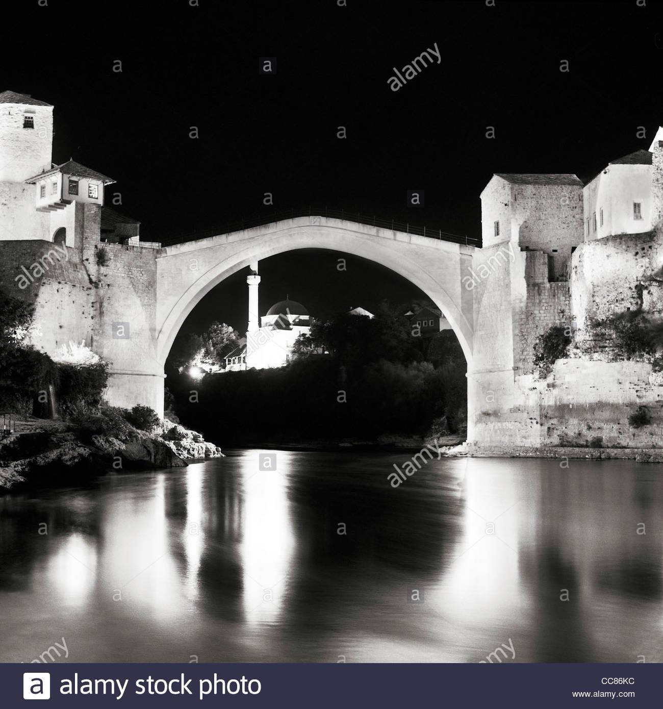 Stari Most (Old Bridge) over Neretva river at night, Mostar, Bosnia and Herzegovina - Stock Image