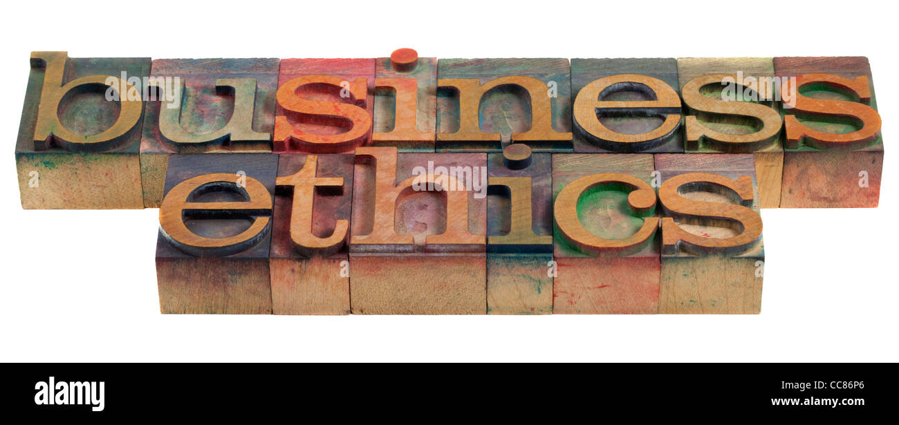 business ethics concept - words in vintage wooden letterpress printing blocks - Stock Image